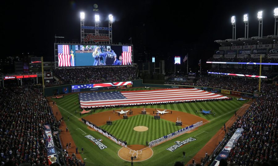 A giant American flag is unfurled before Game 1 of the 2016 World Series at Progressive Field.